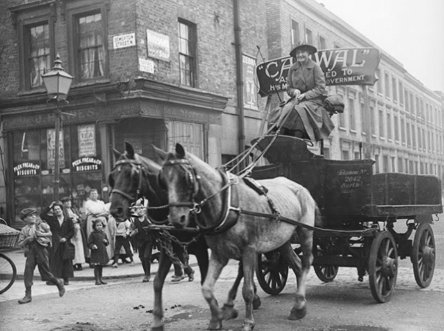 A woman driving a wagon and horses in north London during the first world war. The picture was taken on 16 August 1916. Photograph: Topical Press Agency/Getty.